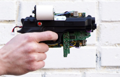 Receipt-printing intant camera gun