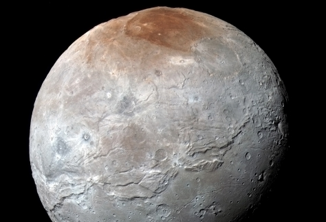 Pluto's moon Charon got its red cap from Pluto